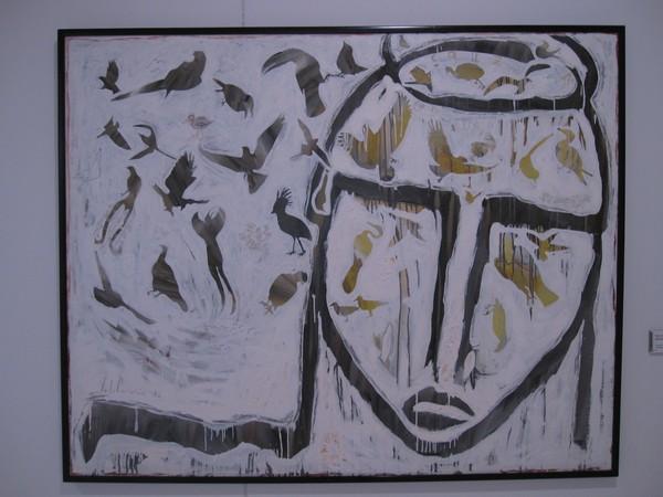 Schilderij van hoofd en vogels