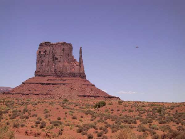 Red single rocks in flat desert